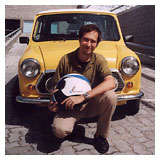 Kein Rodriguez portrait in front of his Mini Cooper