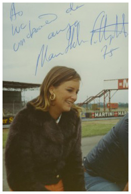 Maria-Helena Fittipaldi sitting on the pitwall