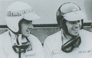 Jim Clark and Jackie Stewart with helmet